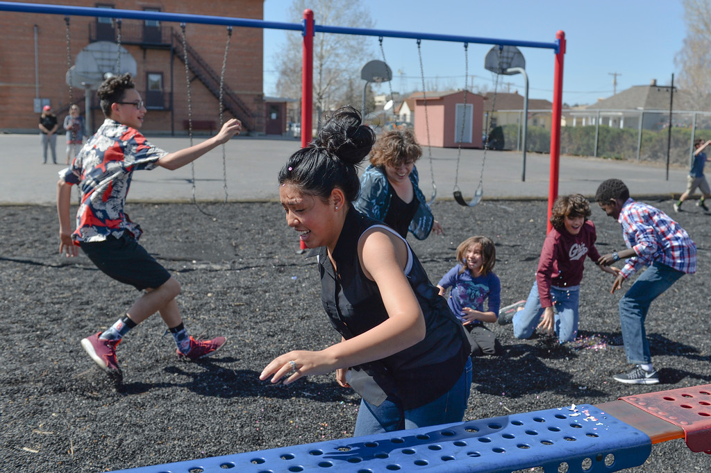 Justin Sheely   The Sheridan Press<br /> Silvia Garza runs away during a hunt for Mexican Cascarones Easter Eggs Thursday at Holy Name Catholic School. Students from spanish language studies made the cascarones by emptying eggs then filling them with confetti. The confetti-filled eggs are part of hispanic tradition that involves cracking the eggs over a person's head. The showering of the confetti is said to bring good luck and good fortune to the recipient. In a religious context, the eggs represent the empty tomb and the resurrection of Jesus.