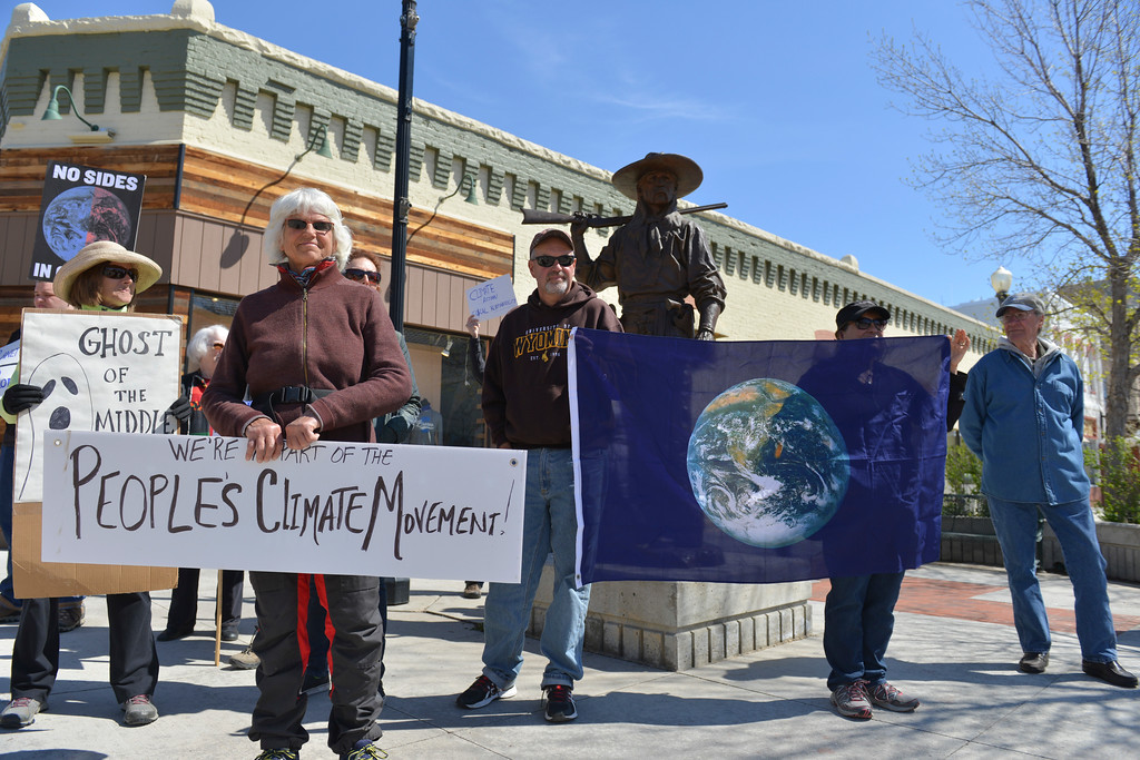 Justin Sheely | The Sheridan Press<br /> Locals protest on Sheridan's Main Street on the 100th day of President Donald Trump in office. Protests were organized across the nation for Trump's policy on Climate Change and other environmental issues.