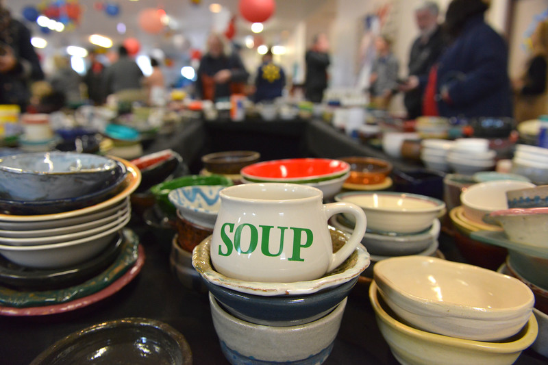 "Justin Sheely | The Sheridan Press<br /> Various bowls are displayed for guests to pick up during the ""Filling and Empty Bowl"" VOA soup fundraiser at the Sheridan County Fairgrounds Exhibit Hall. The annual event supports homeless services in Sheridan operated by Volunteers of America of the Northern Rockies."