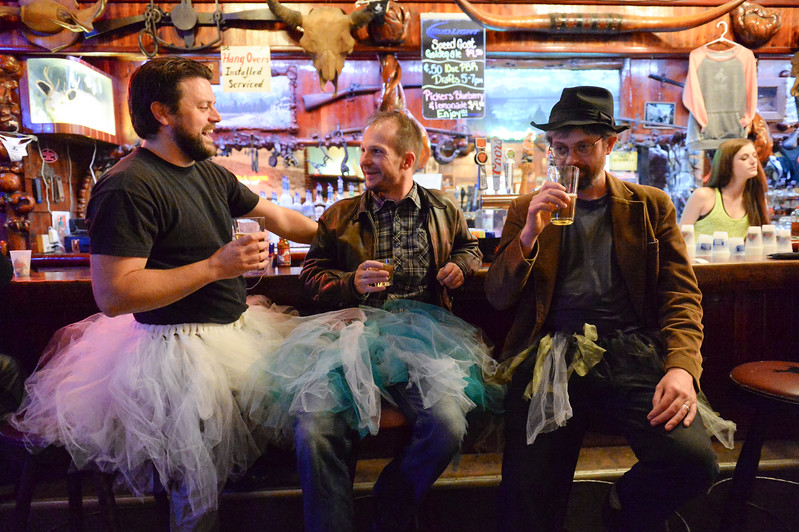 "Justin Sheely | The Sheridan Press<br /> From left, David Meyers, Bill Matteson and Kevin Knapp enjoy drinks during the ""Live and Let Tutu"" response Saturday night at the Mint Bar in Sheridan. Sheridan residents took part in a state-wide response to comments made by U.S. Sen. Mike Enzi, R-Wyoming, to middle school students in Greybull on April 20, when he was asked about federal protections for LGBT people. The senator reportedly said that he knows a guy who wears a tutu to bars and and always surprised that he gets in fights, ""he kind of asks for it a little bit."" Enzi said."