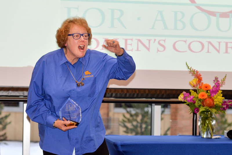 "Justin Sheely | The Sheridan Press<br /> Tempe Murphy yells ""Go Broncs"" after accepting the Woman of the Year award during the 2017 FAB Women's Conference Friday at the Sheridan College Whitney Atrium. Murphy was honored along with nominees Carrie Sisson, Sonja Caywood and Marta Ostler."