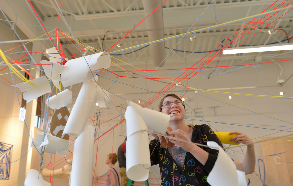 Justin Sheely | The Sheridan Press<br /> Sheridan High School senior Makayla Nielsen hangs string across the gallery for a 3D drawing project during the High School Art Intensive Thursday at the Sheridan College Whitney Center for the Arts. High school students from the area were invited to experience various art forms and make installments at the college.