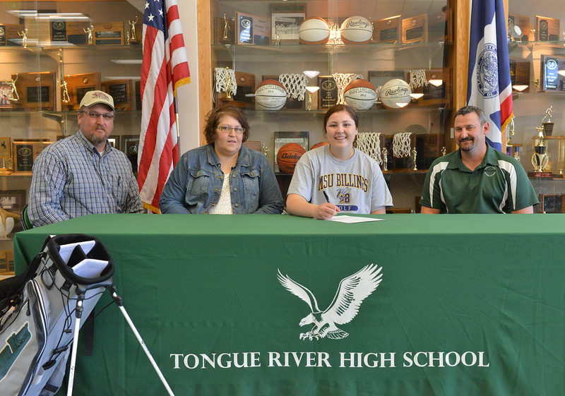 Justin Sheely | The Sheridan Press<br /> Tongue River senior Kylee Knobloch, second from right, signs her letter of intent to play golf at Montana State University Wednesday at Tongue River High School in Dayton. From right, Kylee's parents Jack Knobloch, Kim Knobloch and golf coach Robert Griffin.