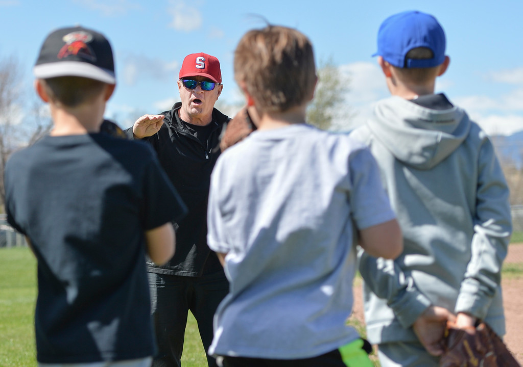 Justin Sheely | The Sheridan Press<br /> JB Barosh instructs the students on how to move to catch fly balls during Sheridan Recreation District's Spring Baseball Clinic Saturday at Oatts Field in Sheridan.