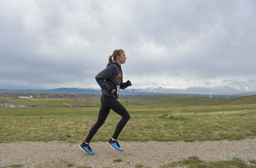 "Justin Sheely | The Sheridan Press<br /> Katelyn Kayser runs in front of a view of the Bighorns during the ""Lead the Way"" 5k Saturday at Soldier Ridge Trail in Sheridan. The race was organized by Sheridan High School's National Honors Society to support Wyoming Big Brothers Big Sisters."
