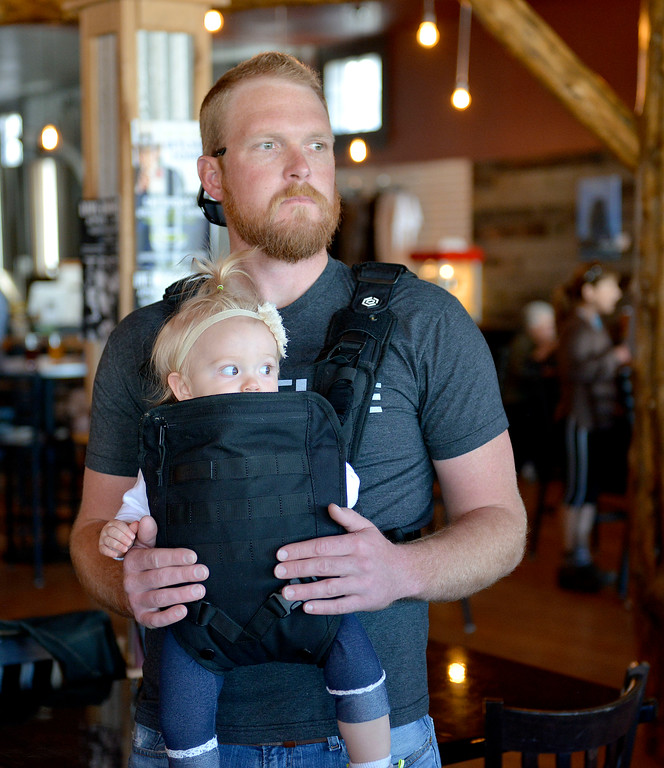 Justin Sheely | The Sheridan Press<br /> Kevin Dieterich holds Lily Dieterich, 1, during the Habitat for Humanity event Tuesday night at Luminous Brewhouse in Sheridan. Thrivent Financial donated $50,000 towards the construction of the habitat home for the Peak family. Habitat for Humanity of the Eastern Bighorns builds affordable home for families in the region using volunteer labor and donated materials.