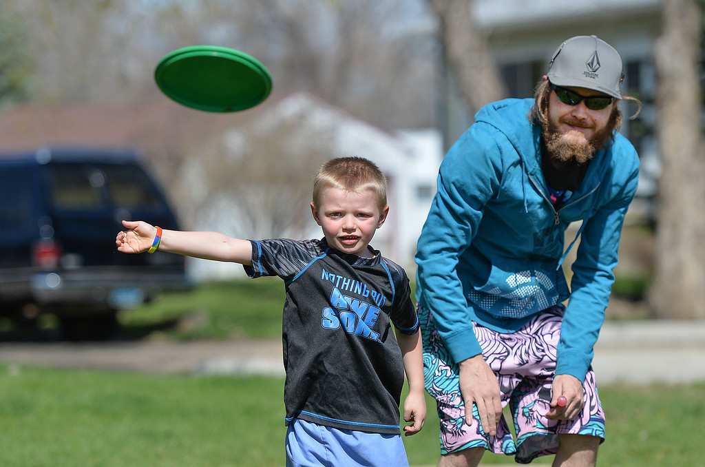 Justin Sheely | The Sheridan Press<br /> Six-year-old Ryker Mines throws a disc as he plays discgolf with Eric Mines at Sheltered Acres Park on a sunny Wednesday afternoon. The National Weather Service is warning of strong wind gusts up to 40 mph on Thursday.