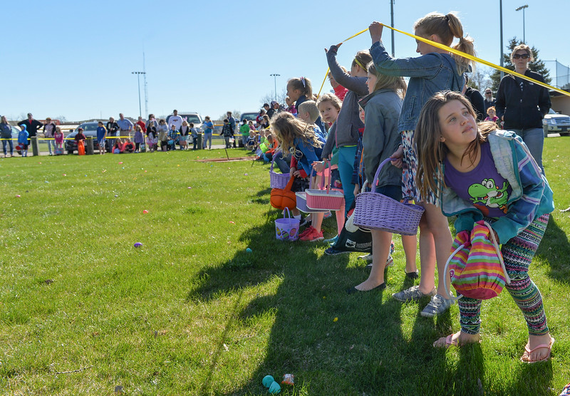 Justin Sheely | The Sheridan Press<br /> Children line up on on a patch of grass during Sheridan Recreation District's Easter Egg Hunt Saturday morning Thorne-Rider Park.