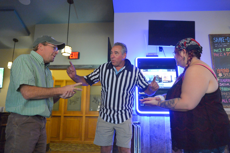 Justin Sheely | The Sheridan Press<br /> Justin Krener, left, competes against Brittany Hamilton as Steve Roush of Big Horn Mountain Beverage Company officiates over the preliminary rounds of Rock, Paper Scissors Thursday in the Main Street Tavern at the Best Western Sheridan Center. Winners from the preliminaries from the past four weeks will be eligible to play the final rounds next Thursday, Aug. 17 at No Name Bar on Main Street to win tickets to the Denver Broncos / Chargers game on Sept. 11 with all expenses paid.