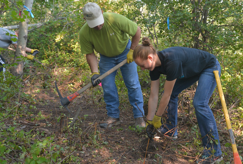 Justin Sheely | The Sheridan Press<br /> Randy Bomar, left, and Peyton Bomar remove roots from the easy trail loop during the Sheridan Community Land Trust's volunteer trail building day Saturday at the Red Grade Trail System west of Big Horn. Volunteers worked on a 700-foot loop trail designed to be less strenuous for beginner hikers. The loop begins and ends at the first gravel parking lot for the trail system. Organizers said that the focus of volunteer day was about community awareness and involvement on the trails. Other public trails in the area include Soldier Ridge Trail at the end of West 5th Street in Sheridan.
