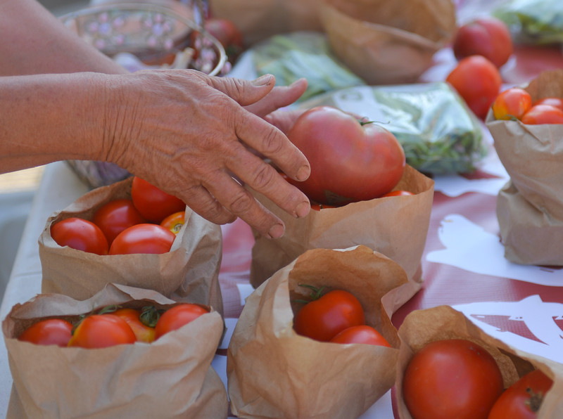 Justin Sheely | The Sheridan Press<br /> A vendor displays tomatoes during the weekly Farmers Market Thursday on Grinnell Plaza. The Farmers Market is every Thursday from 5 – 7 p.m.
