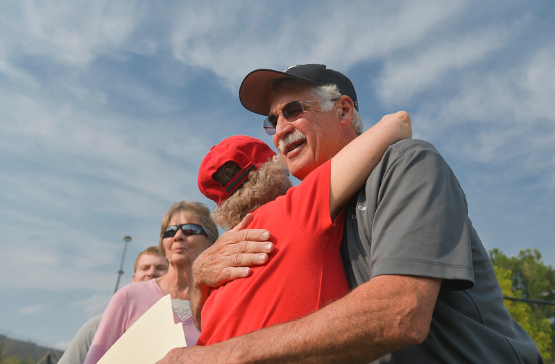 Justin Sheely | The Sheridan Press<br /> Jay McGinnis is embraced by friends during the community celebration for former YMCA Executive Director Jay McGinnis on Friday at the Sheridan YMCA soccer fields. McGinnis is retiring after 40 years at the YMCA.