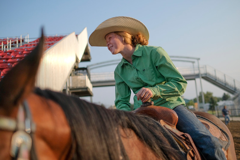 Justin Sheely | The Sheridan Press<br /> Twelve-year-old Karina Bassett visits with other riders during the Sheridan County Rodeo Saturday at the Sheridan County Fairgrounds.