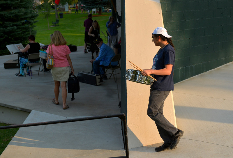 Justin Sheely | The Sheridan Press<br /> Percussionist Lance Yarlott of Ashland, Montana, carries a drum to the band shell during the Concert in the Park Tuesday at Kendrick Park. This was the last night the community band met for Concerts in the Park this summer. The Crossroad Station of Ohio will perform Aug. 15, and Orchard Fire of Nashville, Tennessee, will play on the final night on Aug. 22.