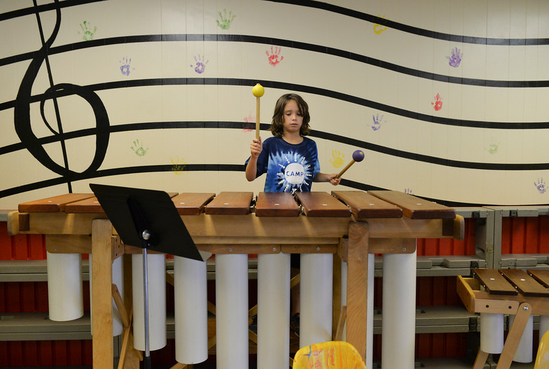 Justin Sheely | The Sheridan Press<br /> Ten-year-old Chase DeAngelis hits notes on a base marimba during the African Marimba Camp on Thursday. The students had two-hour sessions each day of the camp before their show on Friday. Most of the students were playing the instrument for the first time.