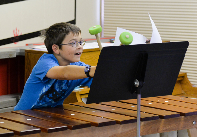 Justin Sheely | The Sheridan Press<br /> Eleven-year-old Jackson Davies flips the sheet music during the African Marimba Camp on Thursday. The students had two-hour sessions each day of the camp before their show on Friday. Most of the students were playing the instrument for the first time.