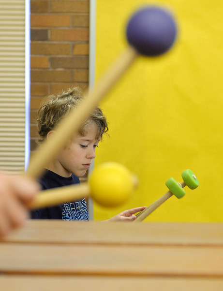 Justin Sheely | The Sheridan Press<br /> Ten-year-old Phelan Sanderson plays with the group during the African Marimba Camp on Thursday. The students had two-hour sessions each day of the camp before their show on Friday. Most of the students were playing the instrument for the first time.