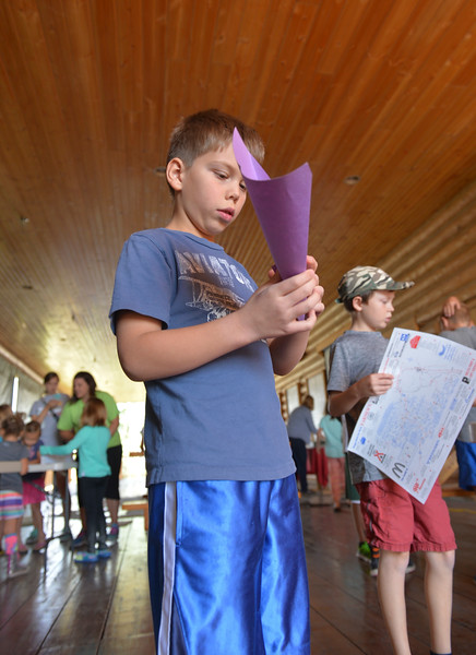 "Justin Sheely | The Sheridan Press<br /> Second-grader Adam Bauers folds a paper airplane during the last Tidbit Tuesday of the season at the Sheridan County Museum. The group learned about the experiences of children during World War I and how civilians were involved in the war effort at home. The children were taught how to make paper airplanes during the craft activity after learning about Charles Schulz's ""Snoppy vs the Red Baron,"" which was influenced by music and pop culture of a generation that still had the experiences of WWI in the public conscience. The museum will move their Tidbit educational events to every third Saturday of the month in the fall."