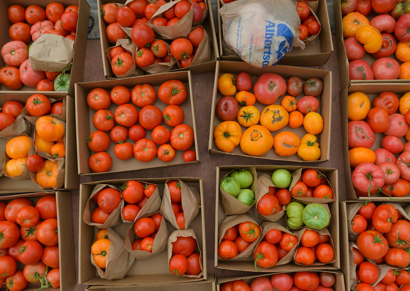 Justin Sheely | The Sheridan Press<br /> Several boxes of tomatoes are displayed during the weekly farmers market Thursday afternoon on Grinnell Plaza.