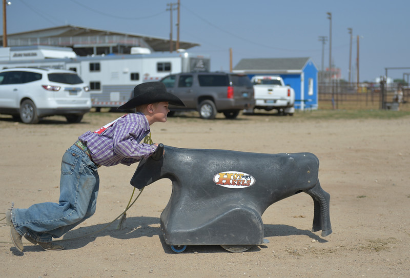 Justin Sheely | The Sheridan Press<br /> Eight-year-old Revyn Floyd of Buffalo, South Dakota, pushes a mechanical roping dummy during the Sheridan Elks Youth Rodeo Saturday at the Sheridan County Fairgrounds.