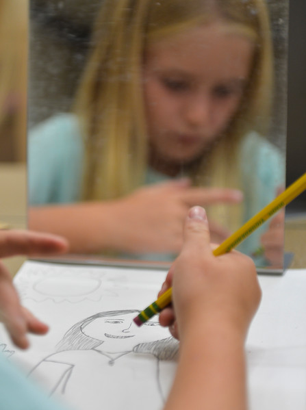 Justin Sheely | The Sheridan Press<br /> Fifth-grader Acacia Switzer draws a self-portrait during the first week of school Tuesday at Tongue River Elementary School in Ranchester. Sheridan County School District 1 began classes on Monday. SCSD2 begins next week.