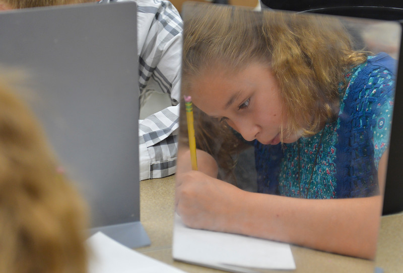 Justin Sheely | The Sheridan Press<br /> Fifth-grader Anna Schilling uses a mirror to draw her self-portrait during the first week of school Tuesday at Tongue River Elementary School in Ranchester. Sheridan County School District 1 began classes on Monday. SCSD2 begins next week.