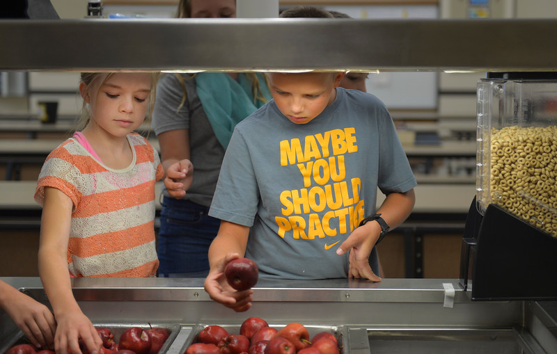 Justin Sheely | The Sheridan Press<br /> Joelliann Olsen, left, and Austen Simonson pick out apples for a mid-morning snack during the first week of school Tuesday at Tongue River Elementary School in Ranchester. Sheridan County School District 1 began classes on Monday. SCSD2 begins next week.