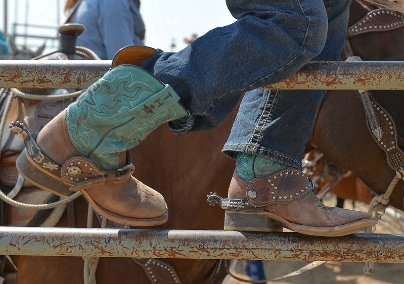 Justin Sheely | The Sheridan Press<br /> A competitor sits on the fence during the Sheridan Elks Youth Rodeo Saturday at the Sheridan County Fairgrounds.