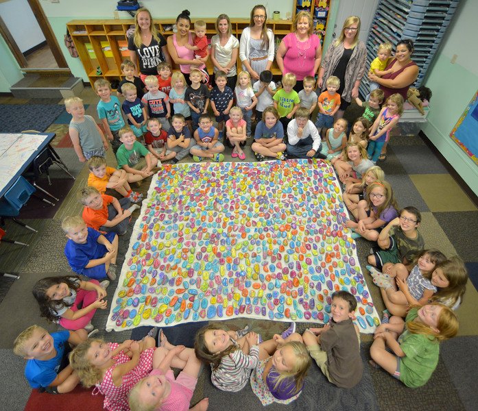 "Justin Sheely | The Sheridan Press<br /> Students at Marion Daycare painted approximately 1000 ""inspirational rocks"" that they will distribute around the community to encourage those who find them. The daycare also created a facebook page for finders to send photos to should they find one of their rocks."