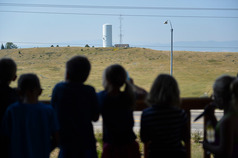 Justin Sheely | The Sheridan Press<br /> Children from a YMCA summer camp look over the view from the deck during the last Tidbit Tuesday of the season at the Sheridan County Museum.
