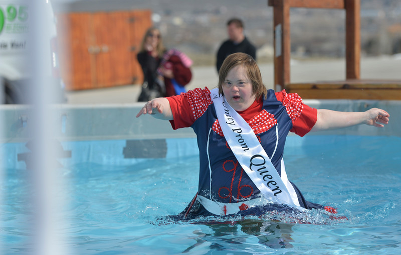 Justin Sheely | The Sheridan Press<br /> Tahia Grosch makes her way to the exit ladder during the annual Jackalope Jump Saturday at Goose Valley Fire Department. Special Olympics athletes, law enforcement agencies and volunteer firefighters jumped in the pool with at temperature of 38 degrees fahrenheit to raise money for the Wyoming Special Olympics.