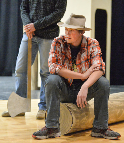 "Justin Sheely | The Sheridan Press<br /> Tongue River sophomore Wyatt Yeigh sits on a log during a rehearsal for ""The Great Tie Flume"" Tuesday at Tongue River High School. The play, written by Tongue River High School teacher Jason McArthur, focuses on life working on the tie flume in the Bighorn Mountains. The show is free, but tickets are required since seating is limited. Curtain opens March 7, 8 and 9 at 7 p.m. Dinner fundraiser is March 7 at 5 p.m. at Tongue River High School. Call Tongue River High School for tickets: 307-655-2236."