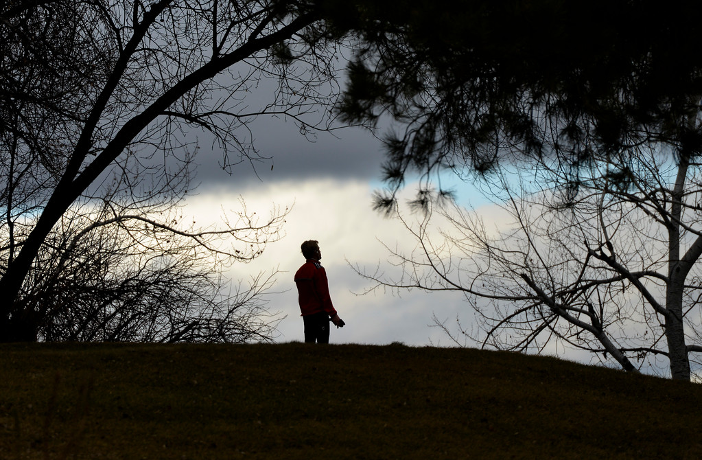 Justin Sheely | The Sheridan Press<br /> A jogger pauses on the hill at the Trail End State Historic Site above Kendrick Park Wednesday in Sheridan. Colder temperatures and 5 - 10 inches of snow are expected Thursday through Friday, according to a winter storm warning issued by the National Weather Service.
