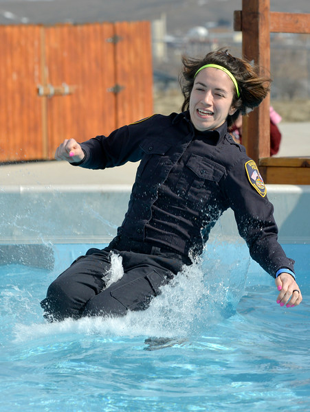 Justin Sheely | The Sheridan Press<br /> Sheridan Police Officer Annalisa Jones takes the plunge during the annual Jackalope Jump Saturday at Goose Valley Fire Department. Special Olympics athletes, law enforcement agencies and volunteer firefighters jumped in the pool with at temperature of 38 degrees fahrenheit to raise money for the Wyoming Special Olympics.