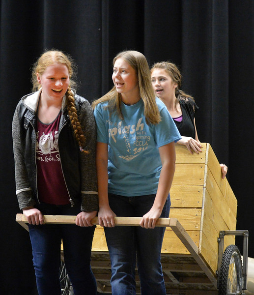 "Justin Sheely | The Sheridan Press<br /> Seniors Emma Balstad, left, and Hannah Johnston pull a cart with sophomore Holly Hutchinson during a rehearsal for ""The Great Tie Flume"" Tuesday at Tongue River High School. The play, written by Tongue River High School teacher Jason McArthur, focuses on life working on the tie flume in the Bighorn Mountains. The show is free, but tickets are required since seating is limited. Curtain opens March 7, 8 and 9 at 7 p.m. Dinner fundraiser is March 7 at 5 p.m. at Tongue River High School. Call Tongue River High School for tickets: 307-655-2236."