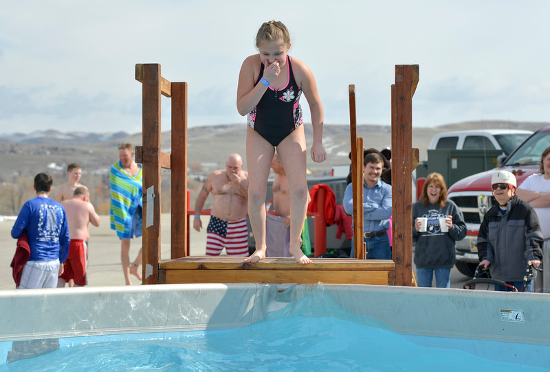 Justin Sheely | The Sheridan Press<br /> Nine-year-old Kaylah Pleines plugs her nose before leaping into the water during the annual Jackalope Jump Saturday at Goose Valley Fire Department. Special Olympics athletes, law enforcement agencies and volunteer firefighters jumped in the pool with at temperature of 38 degrees fahrenheit to raise money for the Wyoming Special Olympics.