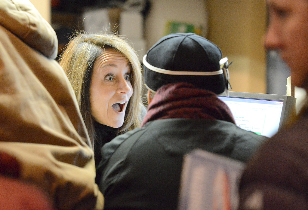Justin Sheely | The Sheridan Press<br /> WYO Theater employee Pam Overton sells tickets to one of the first customers in line on the opening day for Sheridan WYO Rodeo ticket sales Friday morning at the WYO Theater. Every year rodeo fans are given the opportunity to buy the best seats hours before they are made available online. The Sheridan WYO Rodeo 2017 performances are July 12,13,14 and 15. Tickets may be purchased at the WYO Theater Box Office or online at sheridanwyorodeo.com.