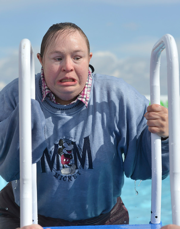 Justin Sheely | The Sheridan Press<br /> Jennifer Hoehne reacts after emerging from the cold water during the annual Jackalope Jump Saturday at Goose Valley Fire Department. Special Olympics athletes, law enforcement agencies and volunteer firefighters jumped in the pool with at temperature of 38 degrees fahrenheit to raise money for the Wyoming Special Olympics.