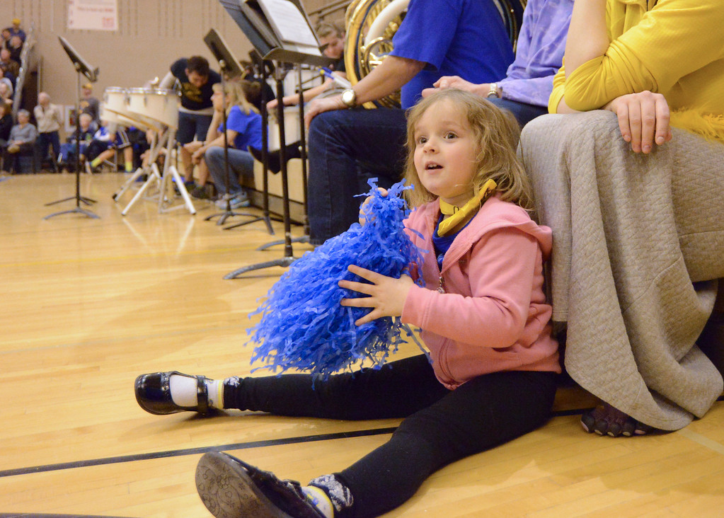 Justin Sheely | The Sheridan Press<br /> Four-year-old Evelyn Mullinax plays with pom poms during the Broncs basketball game Friday at Sheridan High School.