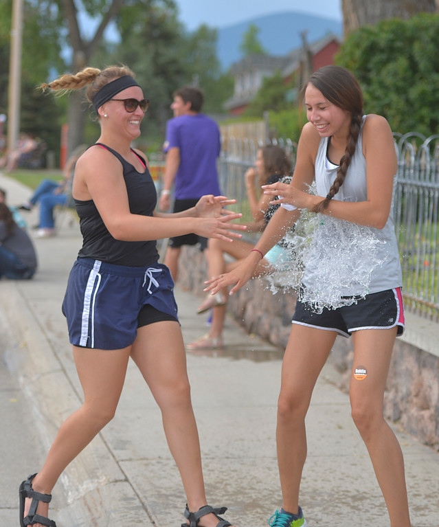 Justin Sheely | The Sheridan Press<br /> Sarah Neilsen, left, hits Amanda Hutchinson with a water balloon during the annual Dayton Days Parade on Saturday.