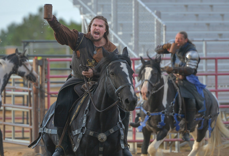 "Justin Sheely | The Sheridan Press<br /> The Knight of Chaos picks up a cup of ""mead"" during the Knights of the Order of Epona tournament Saturday at the Sheridan County Fairgrounds. The event benefited CHAPS Equine Assisted Therapy in Sheridan."