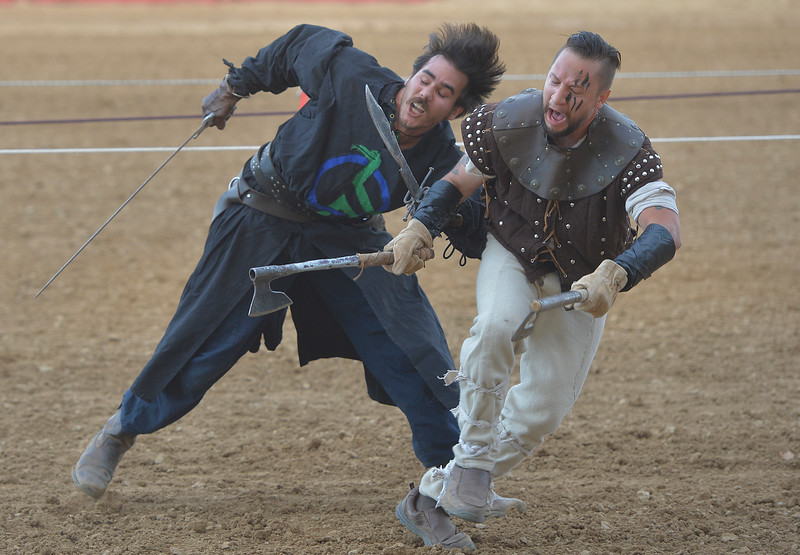 Justin Sheely | The Sheridan Press<br /> <br /> Performers Nolan Gonzales, left and Manny Garza fight during the Knights of the Order of Epona tournament Saturday at the Sheridan County Fairgrounds. The event benefited CHAPS Equine Assisted Therapy in Sheridan.