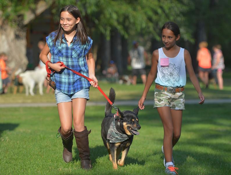 Justin Sheely | The Sheridan Press<br /> Joy Nanibusan, left, and Kayla Nanibusan walk their dog Dolla in the Pet Parade during Dayton Days Friday evening at Scott Park in Dayton.