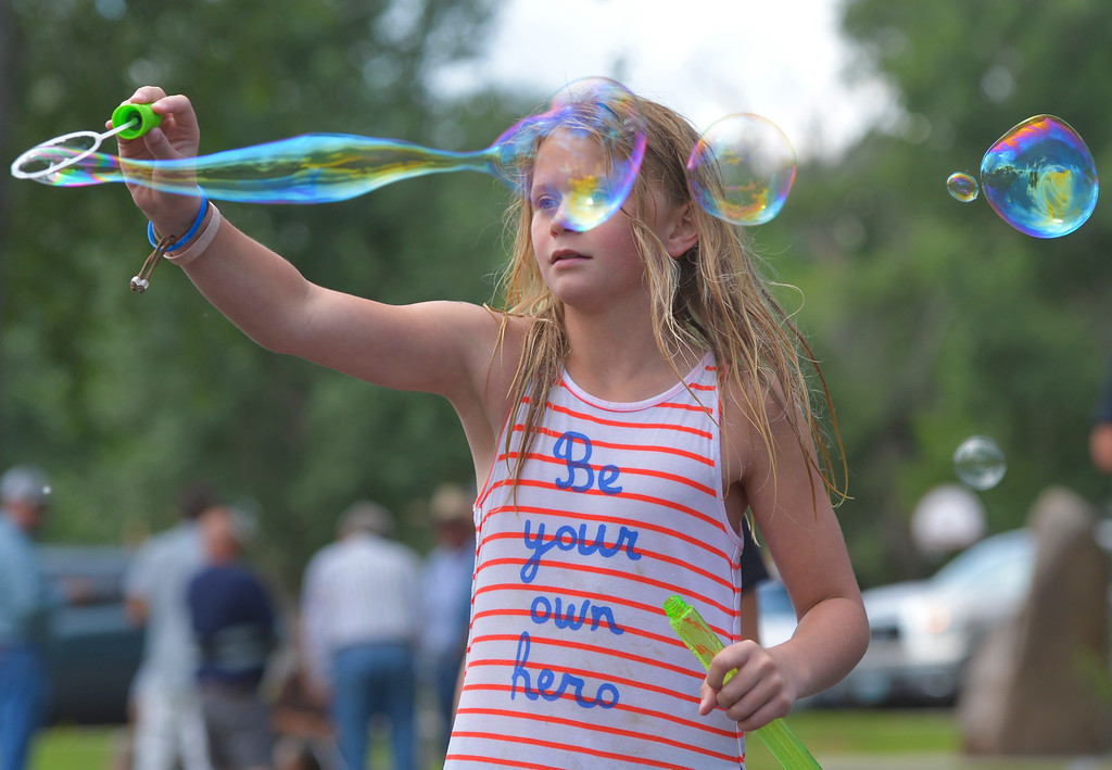 Justin Sheely | The Sheridan Press<br /> Nine-year-old Chaney Reish plays with bubbles during the annual Firemen's Water Fight Saturday at Scott Park in Dayton.