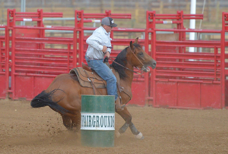Justin Sheely | The Sheridan Press<br /> Brian McCarty competes in the mens barrel racing during the Sheridan Cowgirls Association Rodeo Thursday at the Sheridan County Fairgrounds. The mens race was to benefit the year-end awards banquette. The rodeo was cut short after a thunderstorm dumped rain and hail.