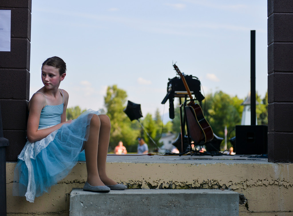 Justin Sheely | The Sheridan Press<br /> Sydni McArthur waits behind the stage during the Tongue River County Stars talent show during Dayton Days Friday evening at Scott Park in Dayton.