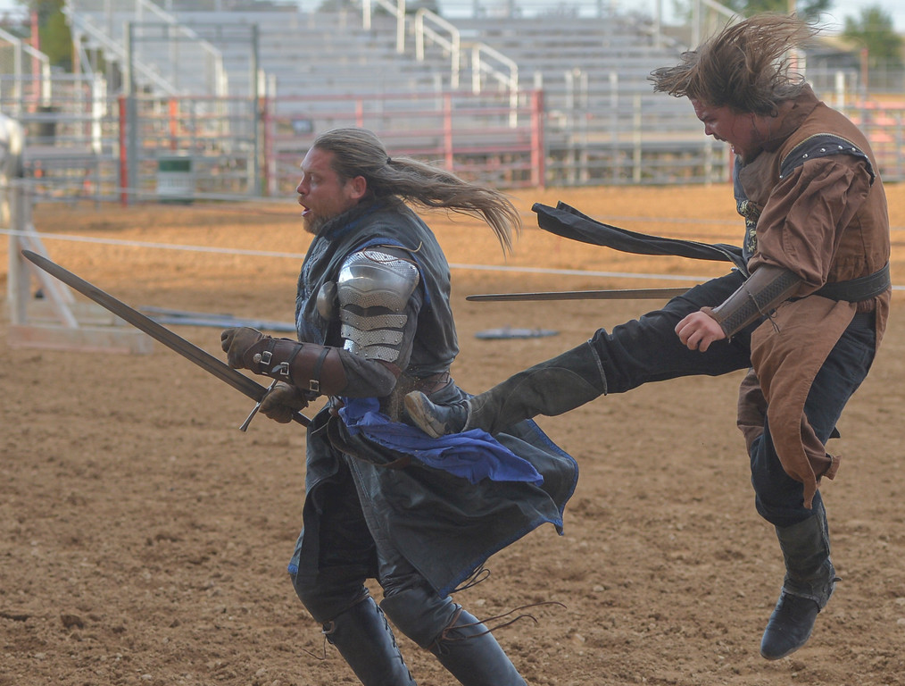 "Justin Sheely | The Sheridan Press<br /> Performers Jeremy ""Sir Rowan"" Johnson. left, and Zach ""Sir Zachary"" Lovering battle each other during the Knights of the Order of Epona tournament Saturday at the Sheridan County Fairgrounds. The event benefited CHAPS Equine Assisted Therapy in Sheridan."