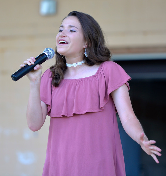 Justin Sheely | The Sheridan Press<br /> Nikki Perfetti sings in the Tongue River County Stars talent show during Dayton Days Friday evening at Scott Park in Dayton.