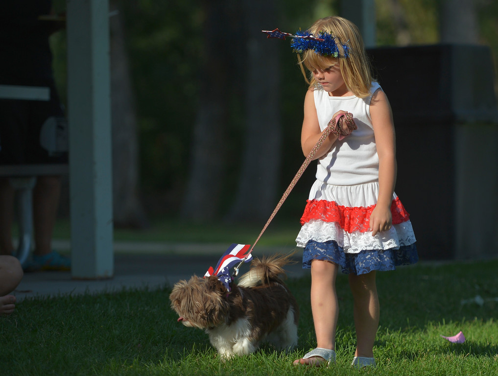 Justin Sheely | The Sheridan Press<br /> Four-year-old Baylan Dickerson walks Jersey in the Pet Parade during Dayton Days Friday evening at Scott Park in Dayton.