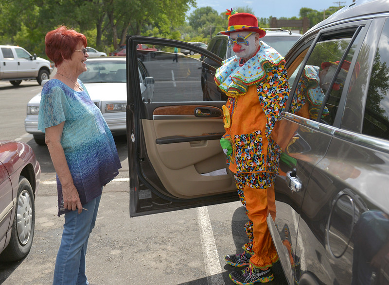 Justin Sheely | The Sheridan Press<br /> Ann Custis, left, watches as Chuck Custis gets out of his vehicle to join the other Kalif Klowns waiting during the annual Dayton Days Parade Saturday in Dayton.